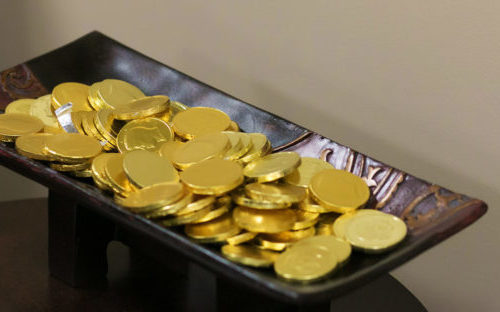 Market uncertainty often has people acting on short-term option, like this pile of gold coins, instead of long-term bonds et al.