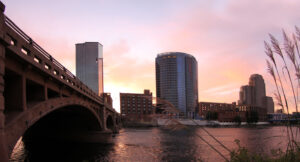 A skyline view of Grand Rapids from the west side at dusk. When financial planning in Grand Rapids, choose Voisard.