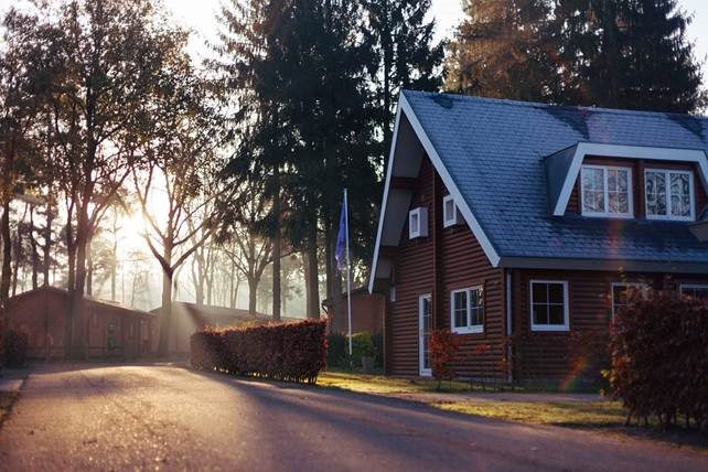 Should I pay off mortgage or invest? An old cottage house at dawn