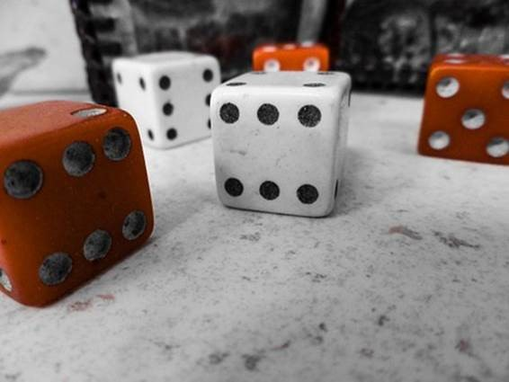 A handful of six-sided dice. Entering the market doesn't have to be a krapshoot with long-term investing approaches.