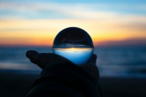 company owner looking at a glass ball to predict it's valuation