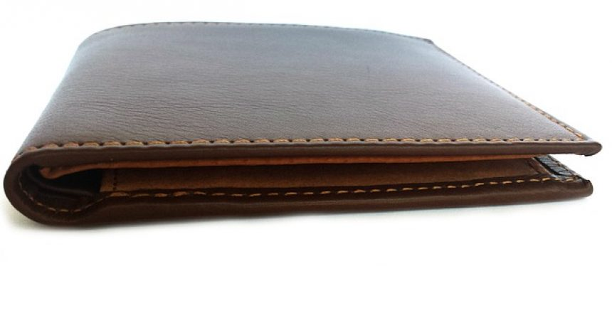A wallet without any money in it. Rising interest rates set by the Federal Reserve can restrict loan access.